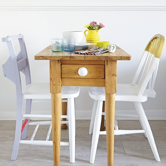 Small-dining-room-with-slimline-table-and-painted-chairs.jpg